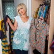 Foto Stock: Woman choosing clothes