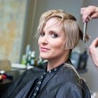 Woman having haircut — Stock Photo