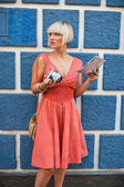 Woman with camera on the street — Stock Photo