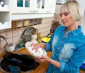 Woman washing dishes — Stock Photo