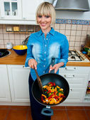 Woman cook vegetable — Stock Photo