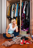 Woman in front of full closet — Stock Photo