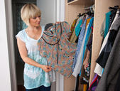 Woman choosing clothes — Stock Photo