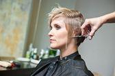 Woman making haircut — Stock Photo