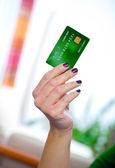 Credit card in hand — Stock Photo