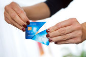 Woman hand holding cut credit card — Stock Photo
