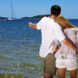 Stock Photo: Couple looking at sea