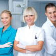 Woman dentist with her assistants — Stock Photo