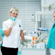 Woman dentist with assistant — Stock Photo #19719447