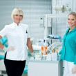 Woman dentist with assistant — Stock Photo