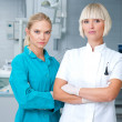 Woman dentist with her assistant — Stock Photo