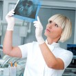 Woman dentist with x-ray image — Stockfoto