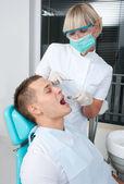 Woman dentist at work — Stock Photo