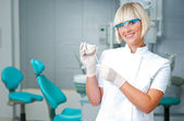 Woman dentist at work — Stock Photo