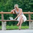 Womwith laptop outside — Stock Photo #19722925