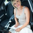 Stock Photo: Woman with laptop in car