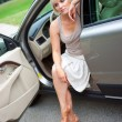 Sad woman sitting in the car — Stock Photo