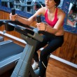 Stock Photo: Woman in gym on bycicle