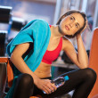 Woman in gym relaxing — Stock Photo #19724173