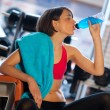 Woman in gym drink — Stock Photo #19724179