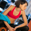 Woman in gym relaxing — Stock Photo