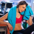 Woman in gym relaxing — Stock Photo #19724215