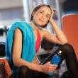 Woman in gym relaxing — Stock Photo #19724245