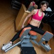 Foto Stock: Womworkout in gym