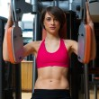 Woman in gym - Stockfoto