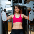Woman workout in gym — Stock Photo #19724345