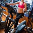 Woman on stepper in gym — Stock Photo