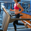 Woman in gym running on track — Stock Photo #19724585