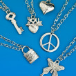 Stok fotoğraf: Collection of silver pendants
