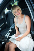 Woman with laptop in car — Stock Photo