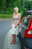 Attractive woman next to car — Stock Photo