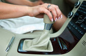 Woman hand and gearshift — Stock Photo
