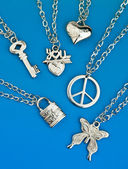 Collection of silver pendants — Stock Photo