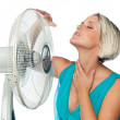 Woman cooling herself — Stock Photo #19778953