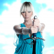 Woman with sword and cross — Stock Photo #19779233