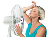 Woman cooling herself — Stockfoto