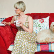 Womand dog on sofa — Stock Photo #19781169