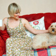 Stock Photo: Womand dog on sofa