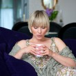 Stock Photo: Womwith coffee on sofa