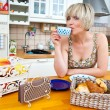 Woman at breakfast table — Stock Photo #19781573