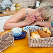 Sleepy woman yawn at breakfast table — Stock Photo #19781711
