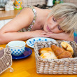 Woman sleepinh at breakfast table — Stock Photo #19781727
