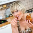 Stock Photo: Womeating breakfast