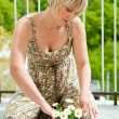 Stock Photo: Womplanting flowers