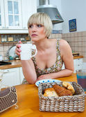 Woman at breakfast table — Stock Photo