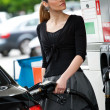 Woman refuel car — Stock Photo